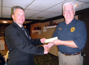 TRF Rotary President Tom Koppenhaver and Police Chief Kim Murphy